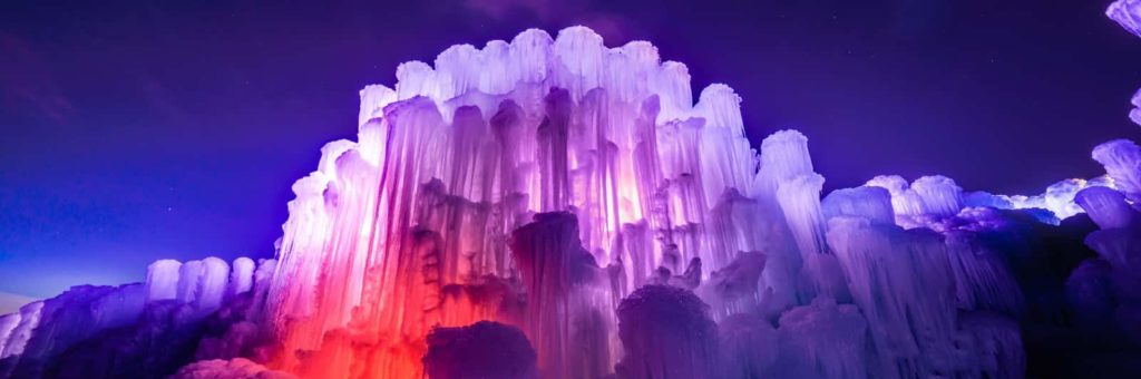Edmonton Ice Castle, lit up in purple and red at night