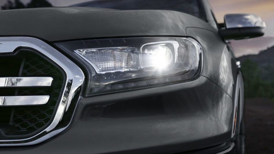 A closeup front view of a black 2019 Ford Rangers LED headlight