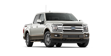 A front three-quater profile shot of a Ford F-150 King Ranch
