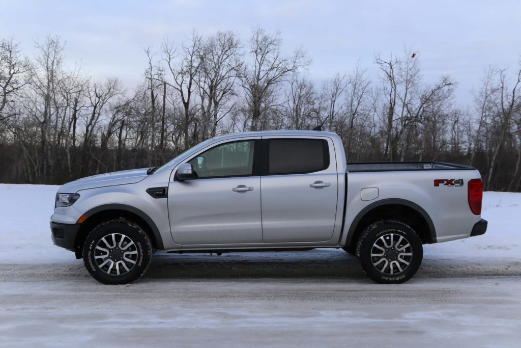 A side view of the 2019 Ford Ranger, parked on a snow covered road