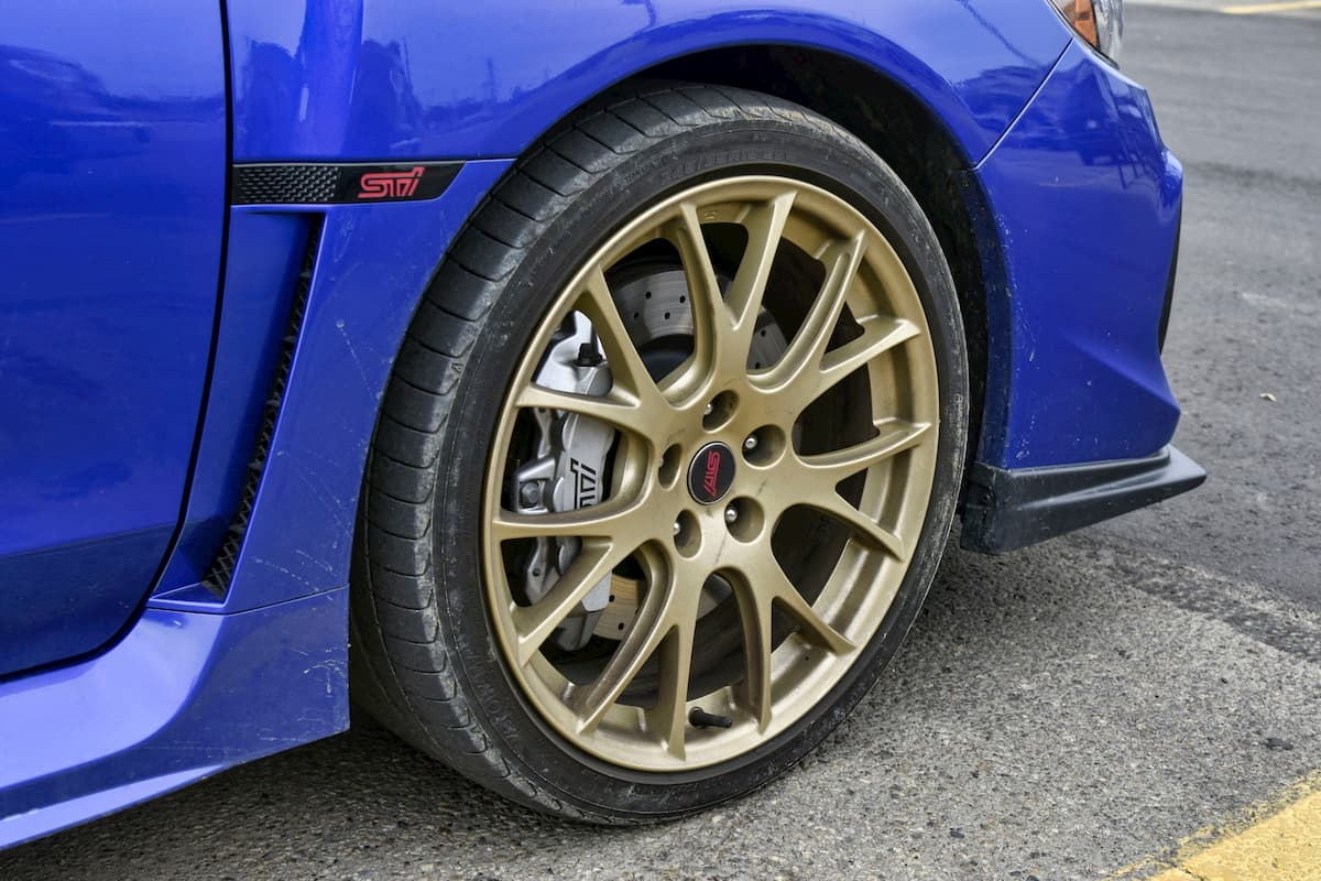 Blue Subaru WRX STi Gold Rim and Wheel Shot