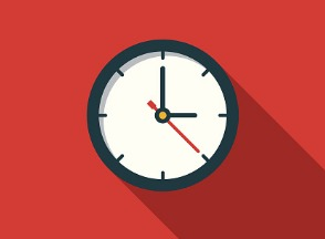 Analog clock hung on red wall