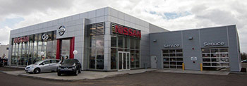 View of Go Nissan North dealership entrance and service bays
