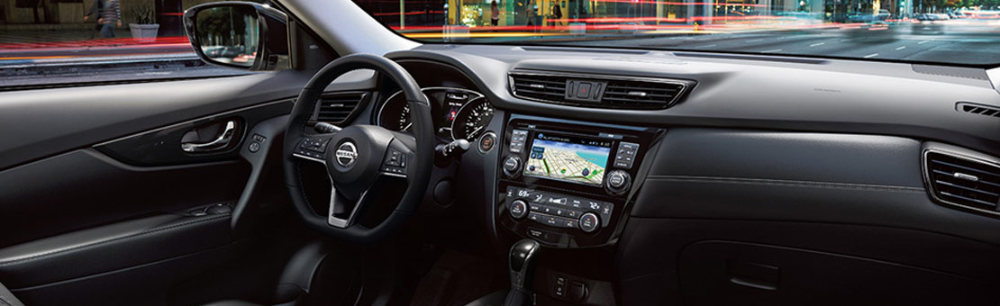 2020 Nissan Rogue interior view of driver console and steering wheel