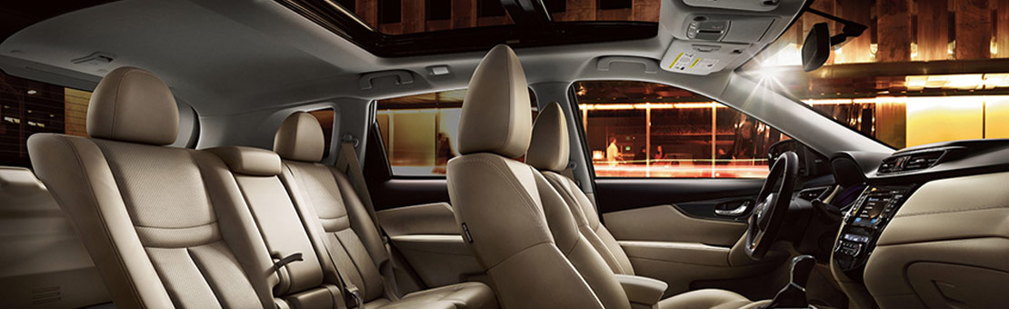 2020 Nissan Rogue interior view of seating layout shown in Almond Leather