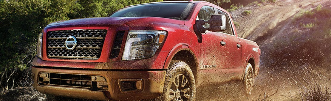 2019 Nissan Titan attacking the terrain shown in Cayenne Red