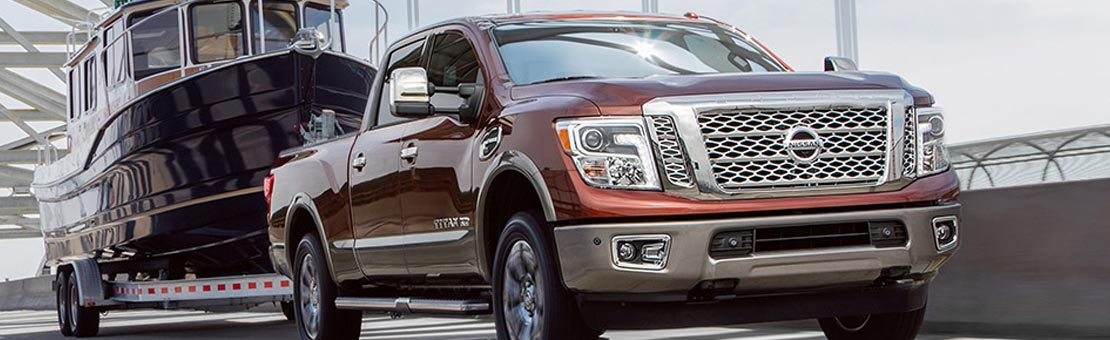 Nissan Titan XD shown in Forged Copper, highlighting towing capacity