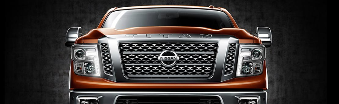 Nissan Titan XD shown in Forged Copper, highlighting front grille