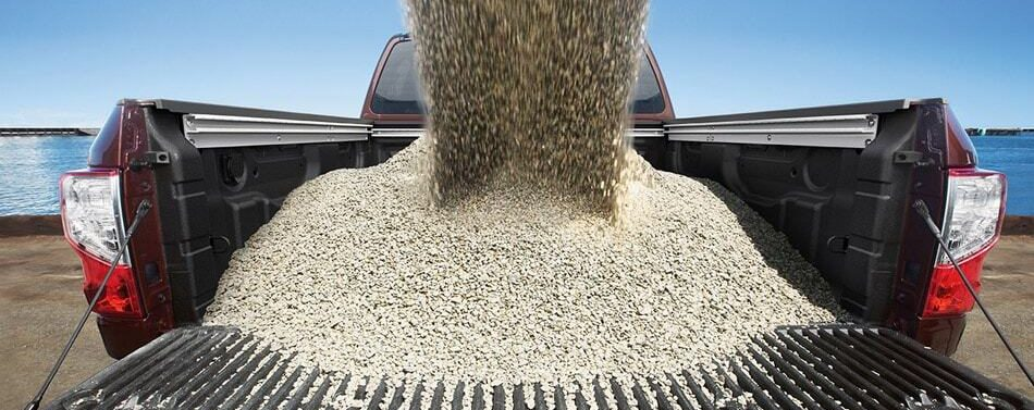 bed of nissan titan being filled with rocks