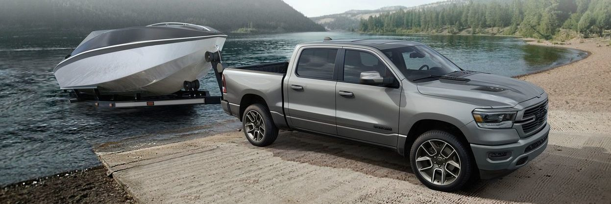 Grey Ram 1500 pulling white boat from water