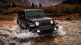 A black 2019 Jeep Wrangler fords a river with ease