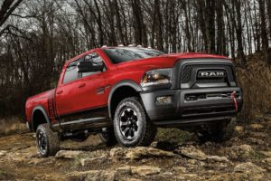 A red RAM 2500 parked out in the woods