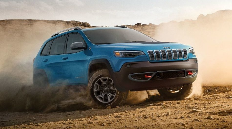 A blue 2019 Jeep Cherokee demonstrates its mastery of the off-road, handling perfectly on sand