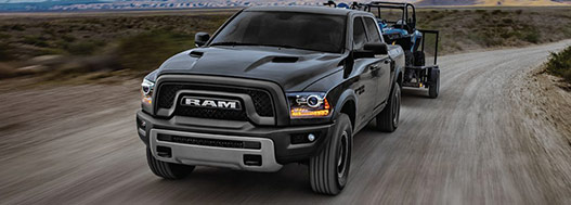 2017 RAM 1500 Towing a trailer with quads