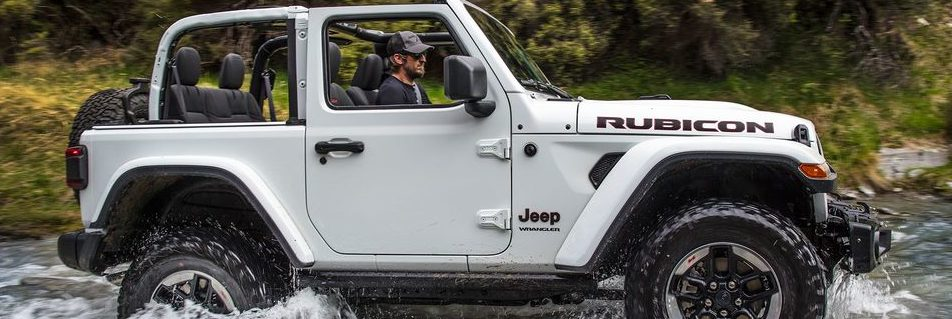 2018 Jeep Wrangler JL Rubicon side profile driving through mud