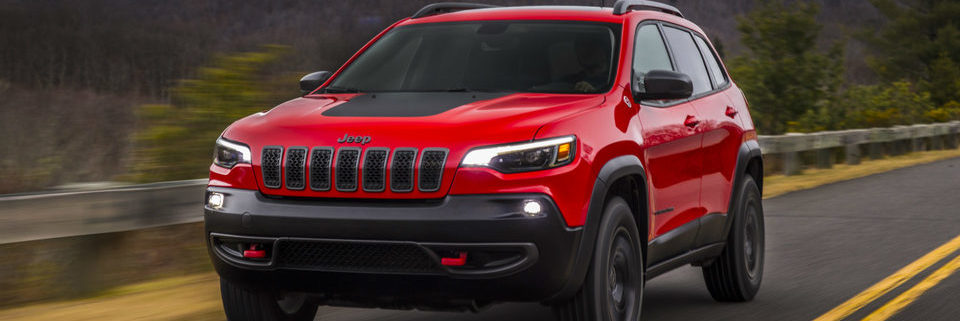 2019 Jeep Cherokee Trailhawk driving on a paved country road