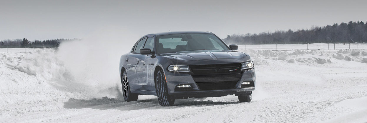 2019 Dodge Charging driving on a snowy plain