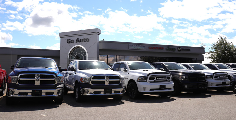 Go Dodge Surrey Lot with a row of Dodge Ram