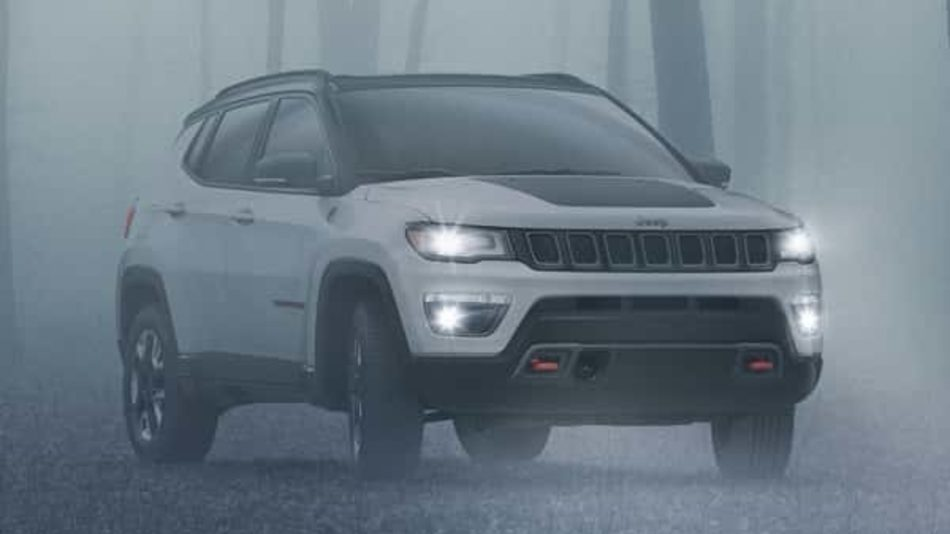 The intimidating 2018 Jeep Compass Trailhawk lurks in a winter fog, in a frozen forest