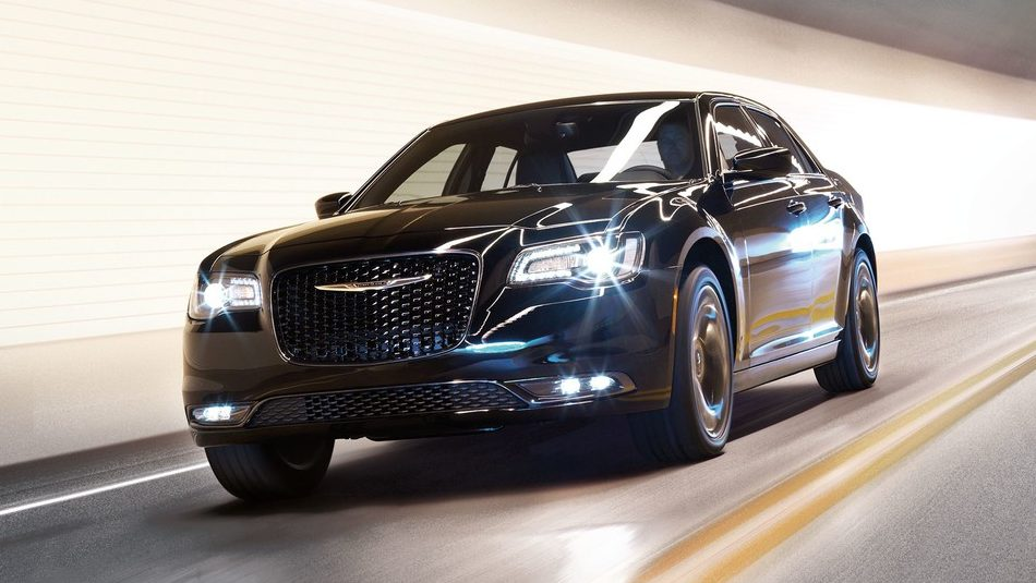 2019 Chrysler 300 with headlights on in a lit tunnel