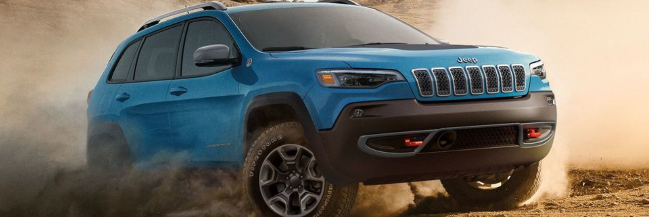 2019 Blue Jeep Cherokee Driving Off-Road