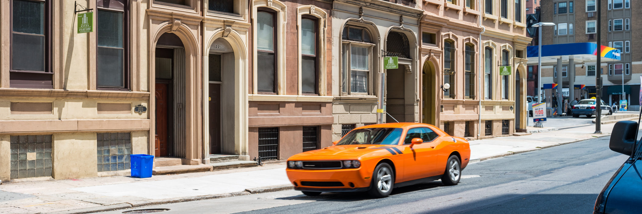 challenger in front of townhouses