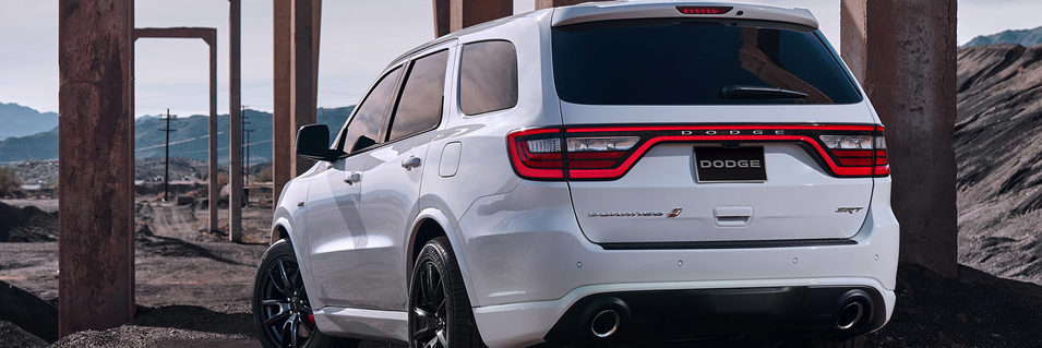 Back three quarters of a White 2018 Dodge Durango SRT in the rugged outdoors