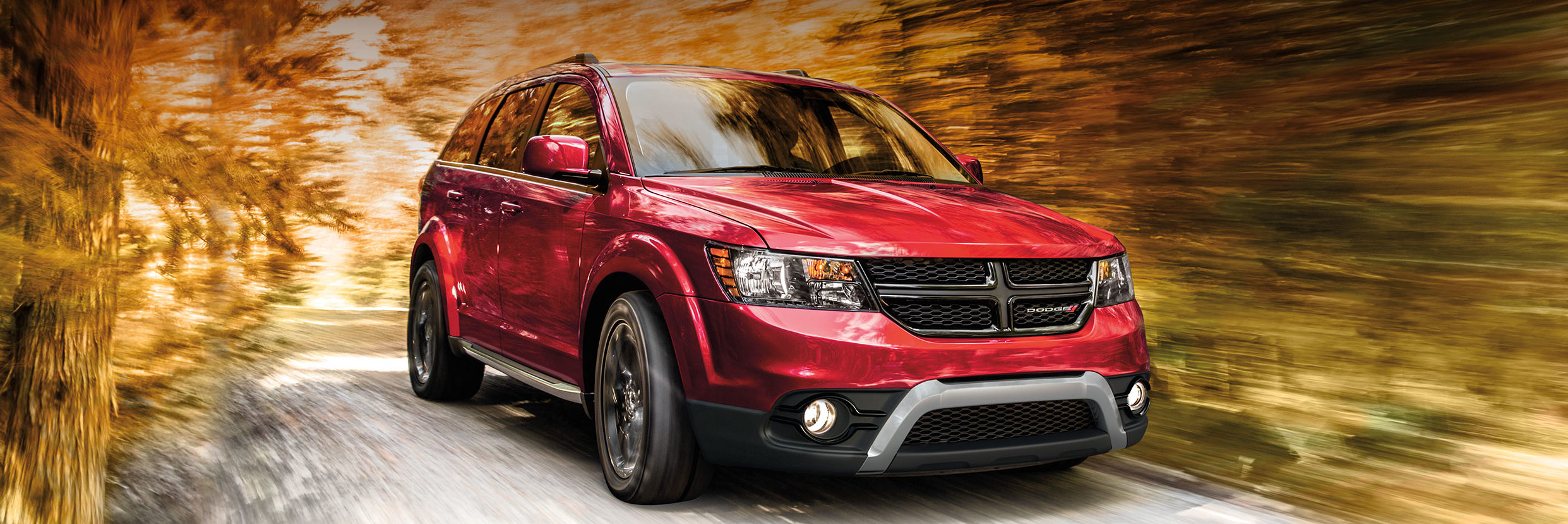 2018 Dodge Journey driving through blurred leaves