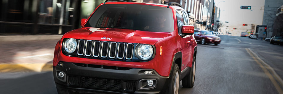 Jeep Renegade driving on a city street