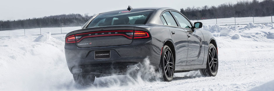 Back of the 2019 Dodge Charger driving in the snow