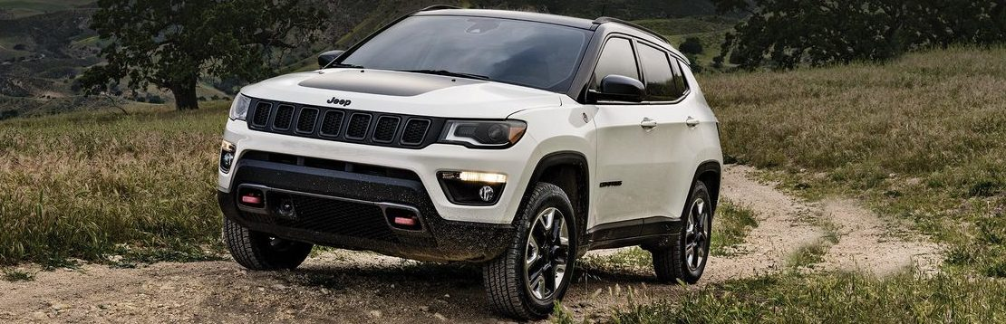 Jeep Compass driving on a dirt road