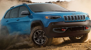 Blue 2019 Jeep Cherokee driving in the dirt