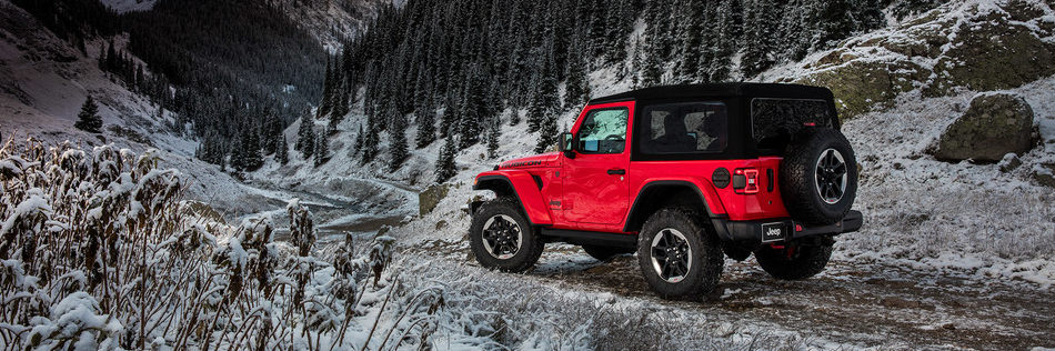 2019 Jeep Wrangler JL soft top in snowy landscape
