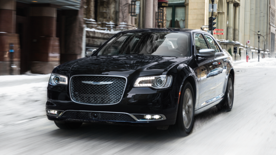 Chrysler 300 driving down a fancy city street
