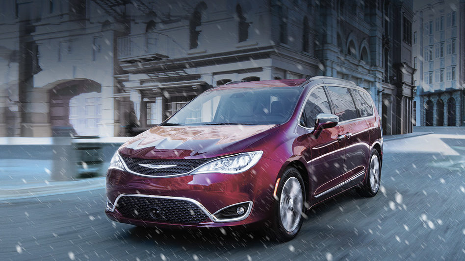2019 Chrysler Pacifica driving on a snow city street