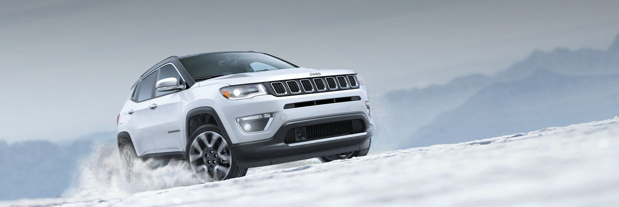2018 Jeep Compass driving up snow covered snow hill