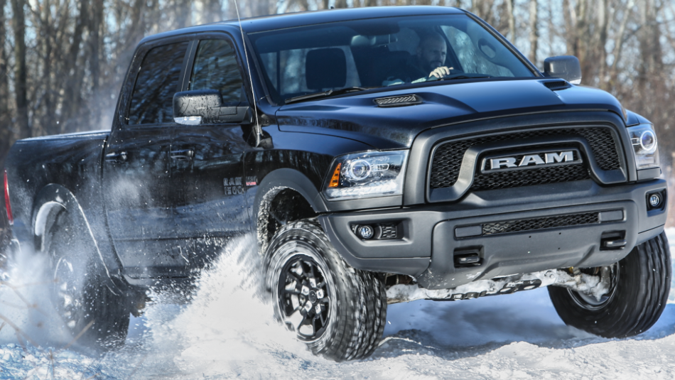 Ram 1500 driving through the snow