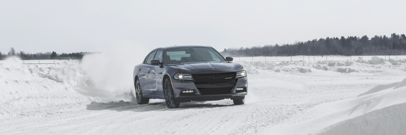 Dodge Charger driving on a snow-covered road