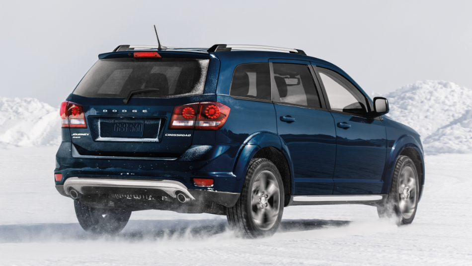 Dodge Journey driving on a snow-covered scene