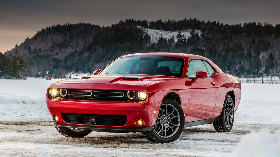 Dodge Challenger parked on a winter landscape