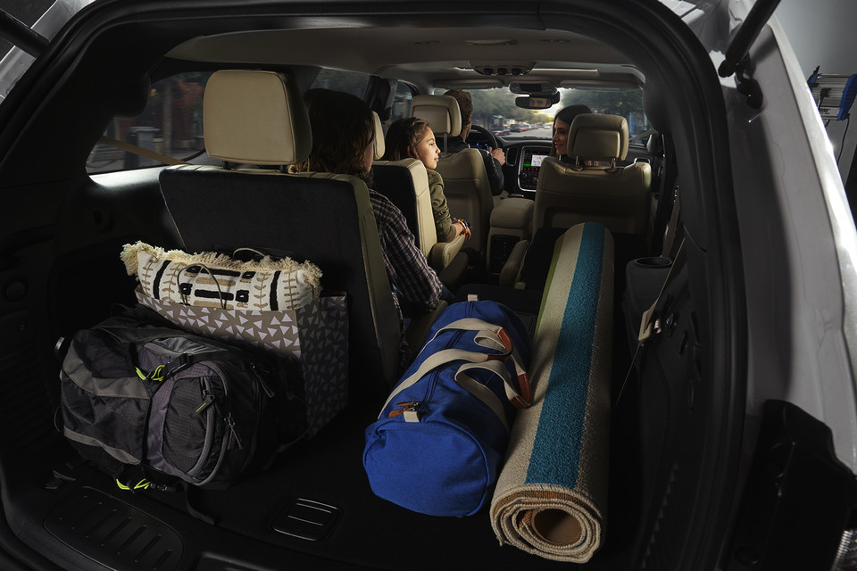 Dodge Durango Interior loaded with camping equipment and young childern