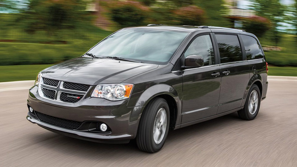 2019 Dodge Grand Caravan driving down road 3/4 view