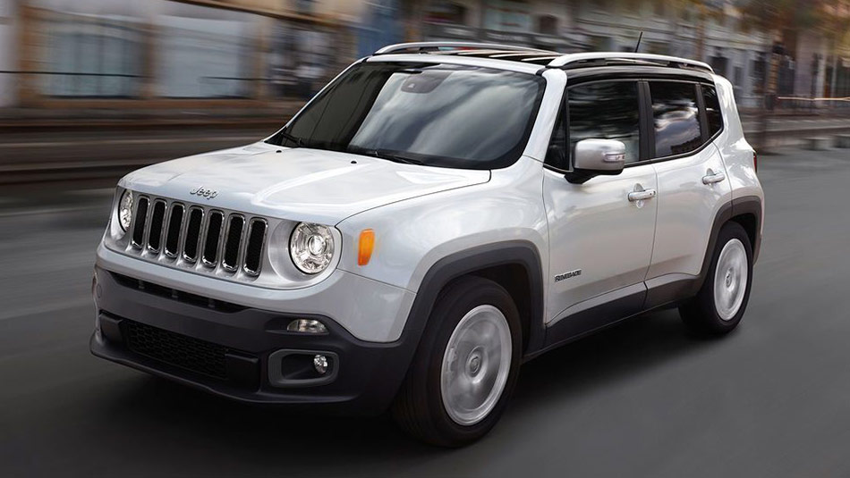 2018 Jeep Renegade driving down a street