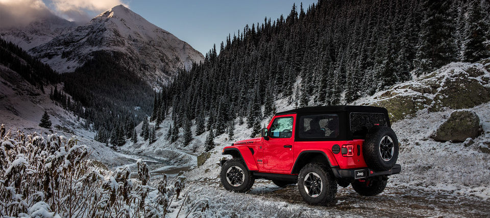 2019 jeep wrangler JL in red, driving on a mountain road