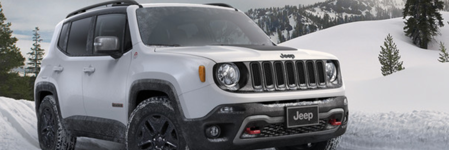Jeep Renegade driving on a snow-covered trail