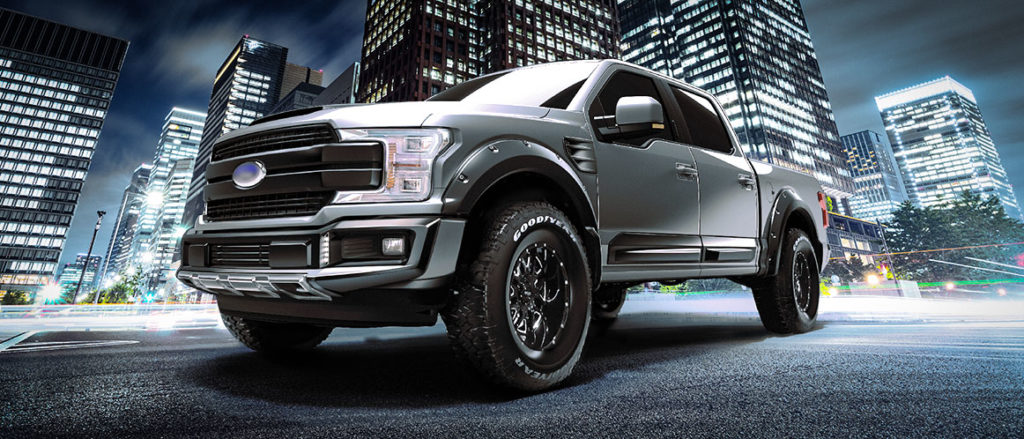 A cool, silver Ford F-150 driving in the city