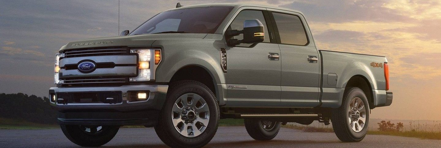 Cargo Green 2019 Ford Super Duty Lariat Crew Cab glistening in the sunset
