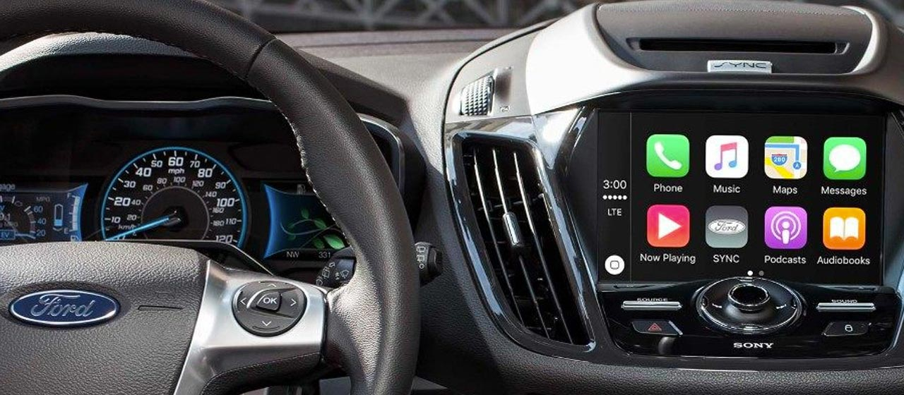 Ford SYNC 3 dashboard with Apple CarPlay displayed on the touch screen