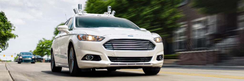 Ford Fusion Hybrid Autonomous driving down the street