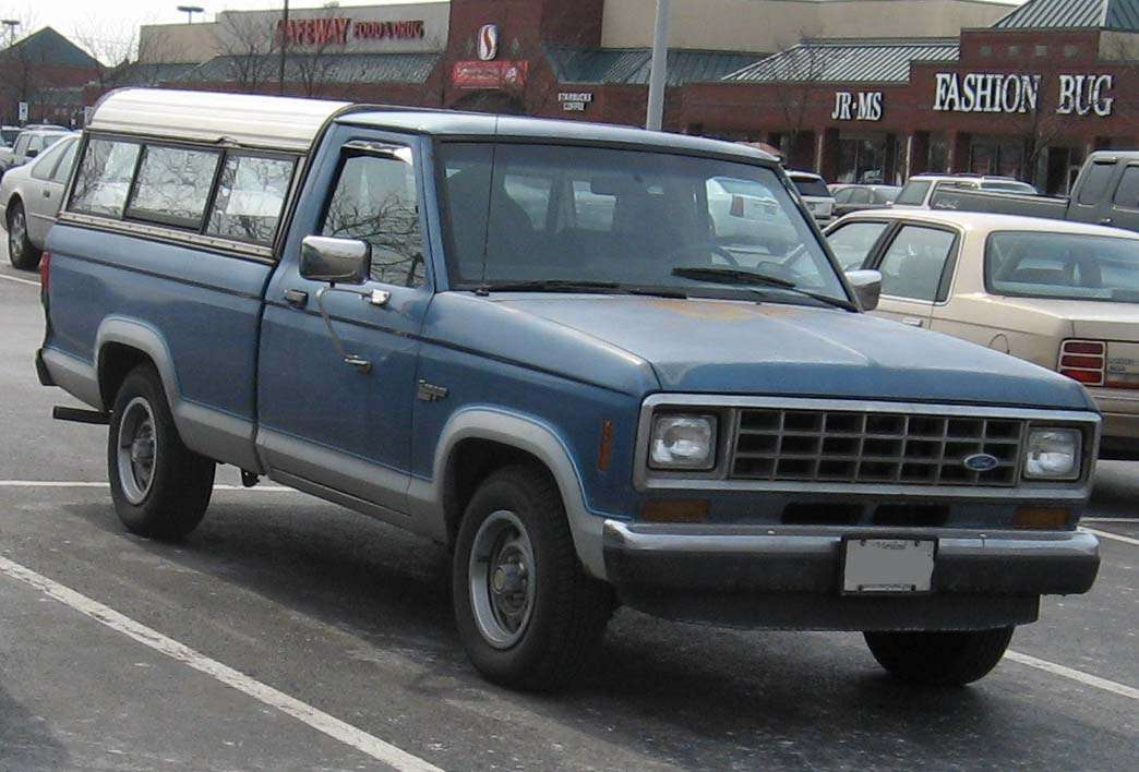 First Generation Ford Ranger in blue with a truckbed cover